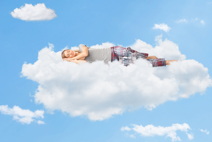 Female patient from Pacific Maxillofacial Center in Honolulu, HI sleeping on a cloud